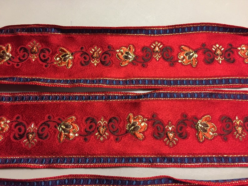 Made in France 2 inch wide Brocade Ribbon with a Navy Blue Metallic Gold Floral Pattern against a Red background Brown
