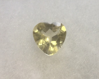Andesine labradorite, yellow heart-shaped natural gemstone.