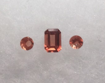 Andesine, a lovely orangy red natural gemstone.