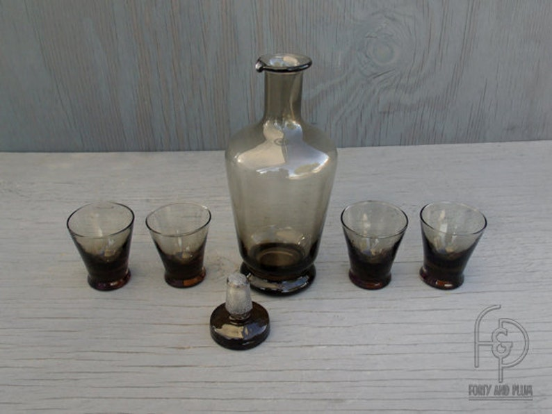 Mid Century/60's Smokey Decanter with Stopper and Four Flared Base Shot  Glasses