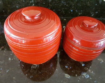 Two retro red/brown  plastic canisters