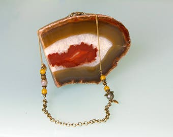 Necklace chain and stone: orange yellow Jade and Labradorite.