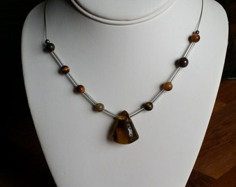 Necklace made with amber and cylinder glass beads