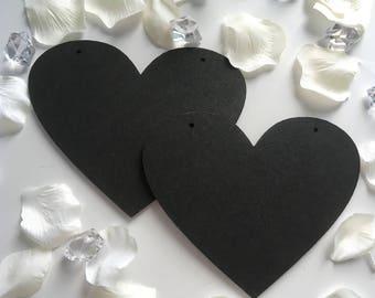 Pair of wooden wedding chalkboard hearts
