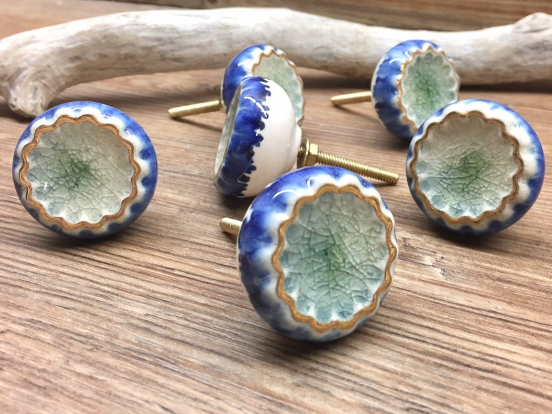 White Gold Mediterranean Blue Round Scalloped Crater Knob and Mint Melted Glass Knob
