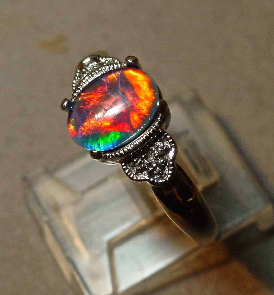 Antique Style Opal Engagement Ring With Diamond Accents