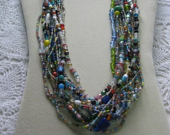 T- One Dozen  Mardi Gras glass bead necklaces from New Orleans-Carnival --Parade