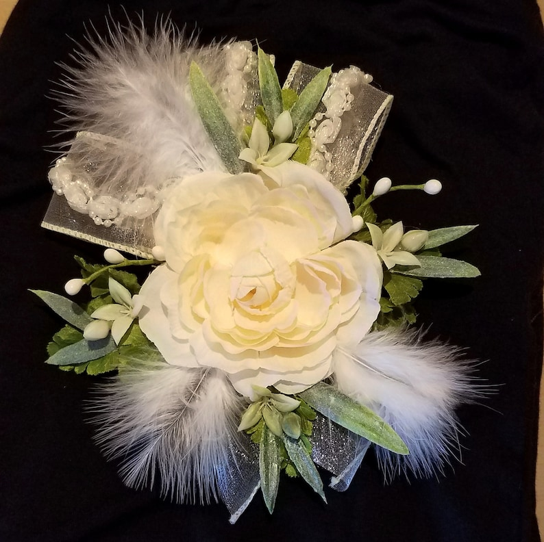 Lace Bridal Corsages With Beautiful Cream Colored Rose Greenery And A Shimmery Ribbon