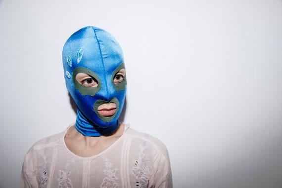 Pastel blue mask with khaki green eye contouring