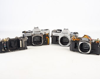 Lot of 4 Canon AE-1 35mm SLR Film Camera Bodies As Is for Parts or Repair