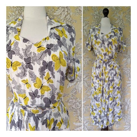 vintage 1950s butterfly print dress