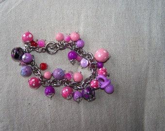 bracelet breloques violettes et roses e1053ba042e