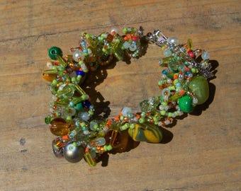 Bracelet multicolor tones green, orange