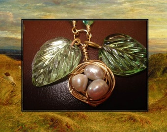 Pretty brass and pearl nest necklace with vintage glass leaves