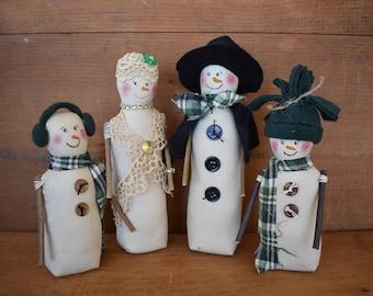 Primitive Snowman Family