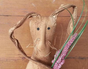 Primitive Grunge Bunny with a Spring Flower