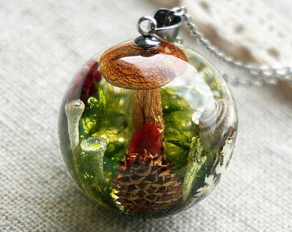Forest necklace with real mushroom, cone, wild strawberry, moss, lichen and cranberry leaves.