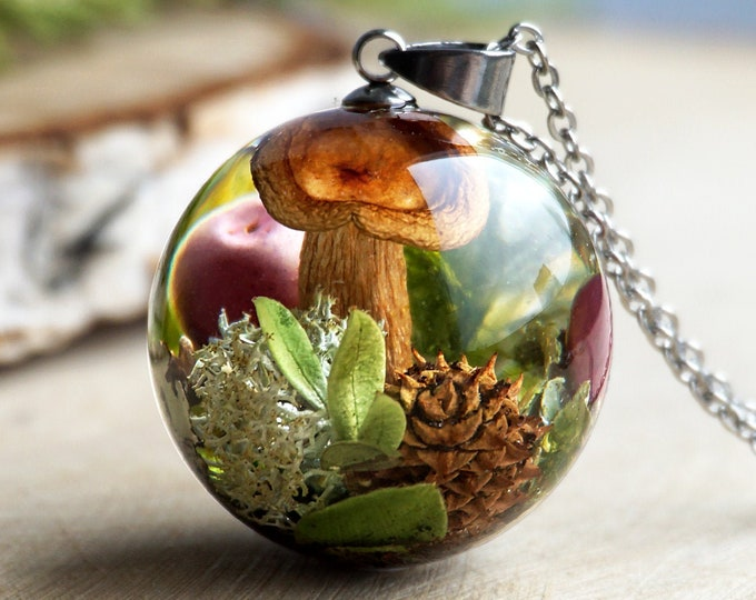 Forest necklace with real mushroom, cone, pink berries, moss, lichen and cranberry leaves.