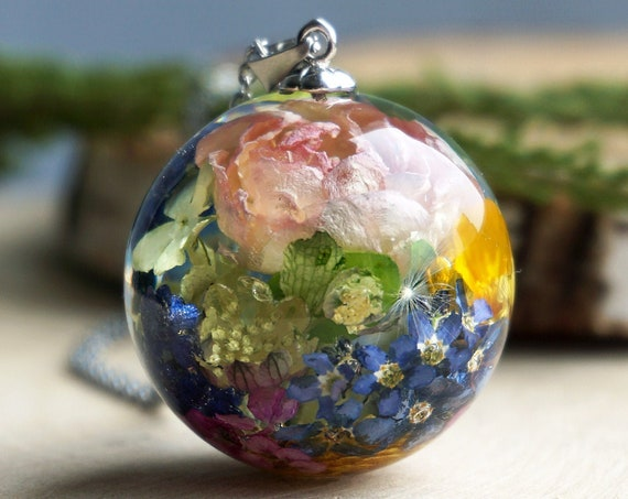 Botanical necklace with Real Rose, Buttercup, Muscari, Astrantia, Forget me not flowers and green leaves.