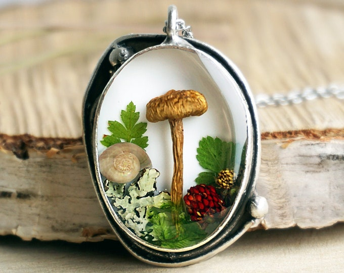 Forest pendant with real mushroom, wild strawberry leaves and berries, lichens, moss & a tiny snail shell.