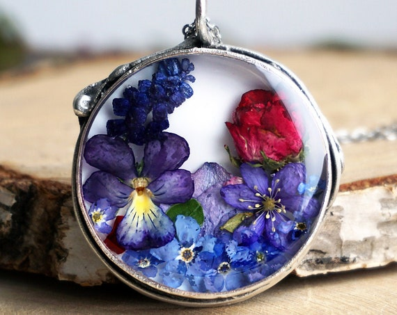 Botanical necklace with Real Viola, Muscari, Hepatica, Red rose and Forget me not flowers.