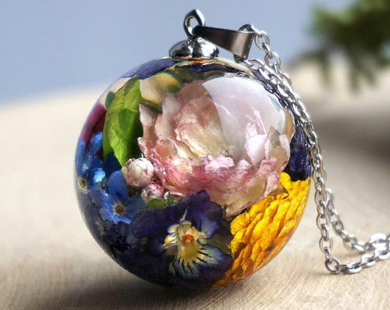 Botanical necklace with Real Rose, Buttercup, Viola, Forget me not flowers, Wild strawberry and green leaves.