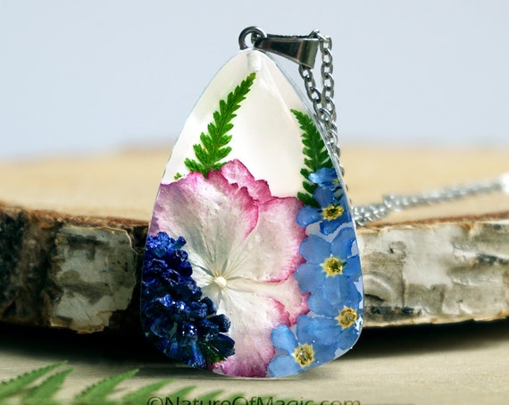Botanical necklace with Real Fern, Muscari, Hydrangea and Forget me not flowers.