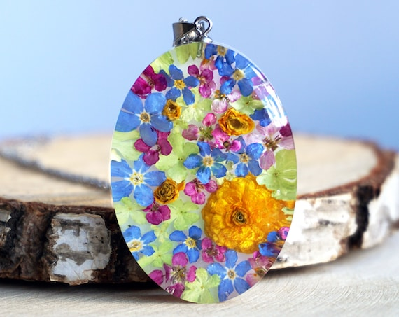 Botanical pendant with Real Buttercups, Alyssum, Viburnum and Forget me not flowers.