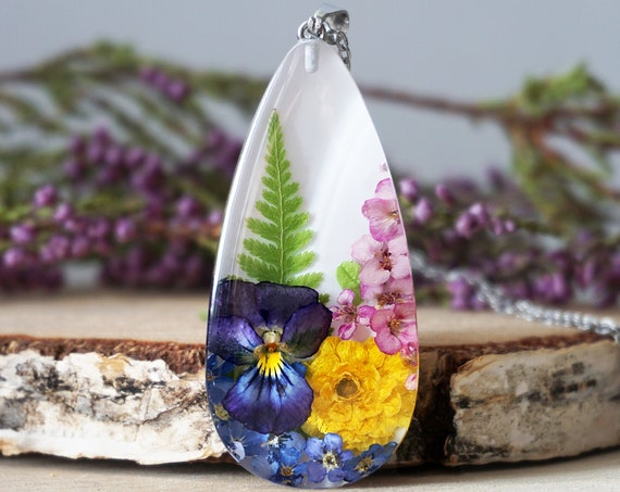 Botanical necklace with Real Viola, Fern, Buttercup, Alyssum and Forget me not flowers.