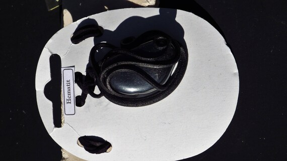 Hematite Pendant set in leather