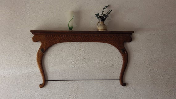 Re-purposed Dresser Harp into coat/towel rack
