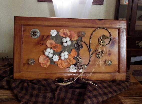 The Old Door - turned useful wall art with knobs/hooks