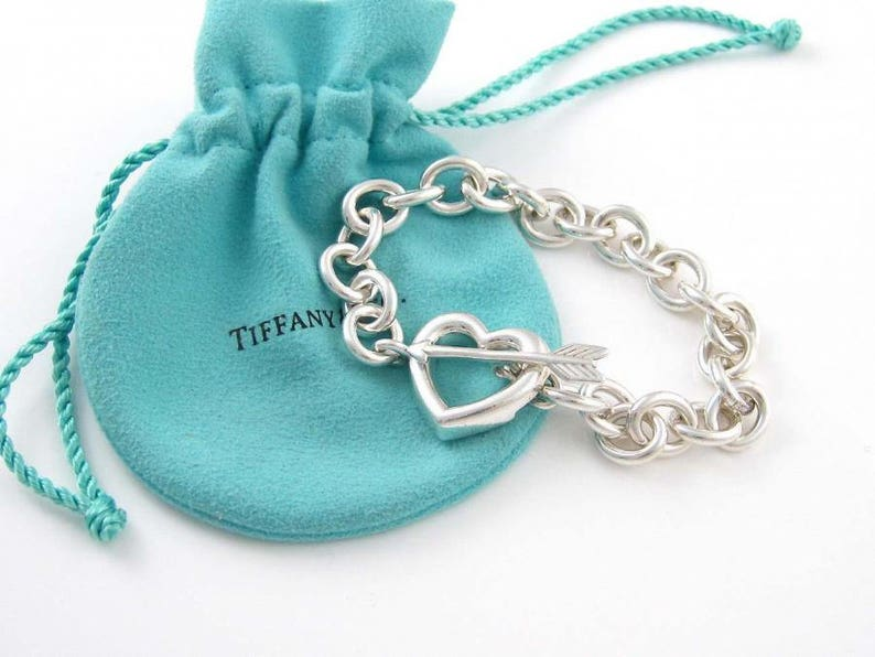 f09e907b29271 Tiffany and Co Sterling Silver Heart and Arrow Toggle Bracelet with Tiffany  Pouch and Box