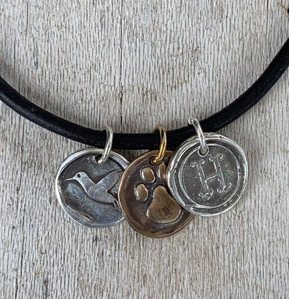 Four Legged Friend Memorial Leather Necklace with Sterling Silver Letter and Hummingbird Charms with Bronze Paw Charm