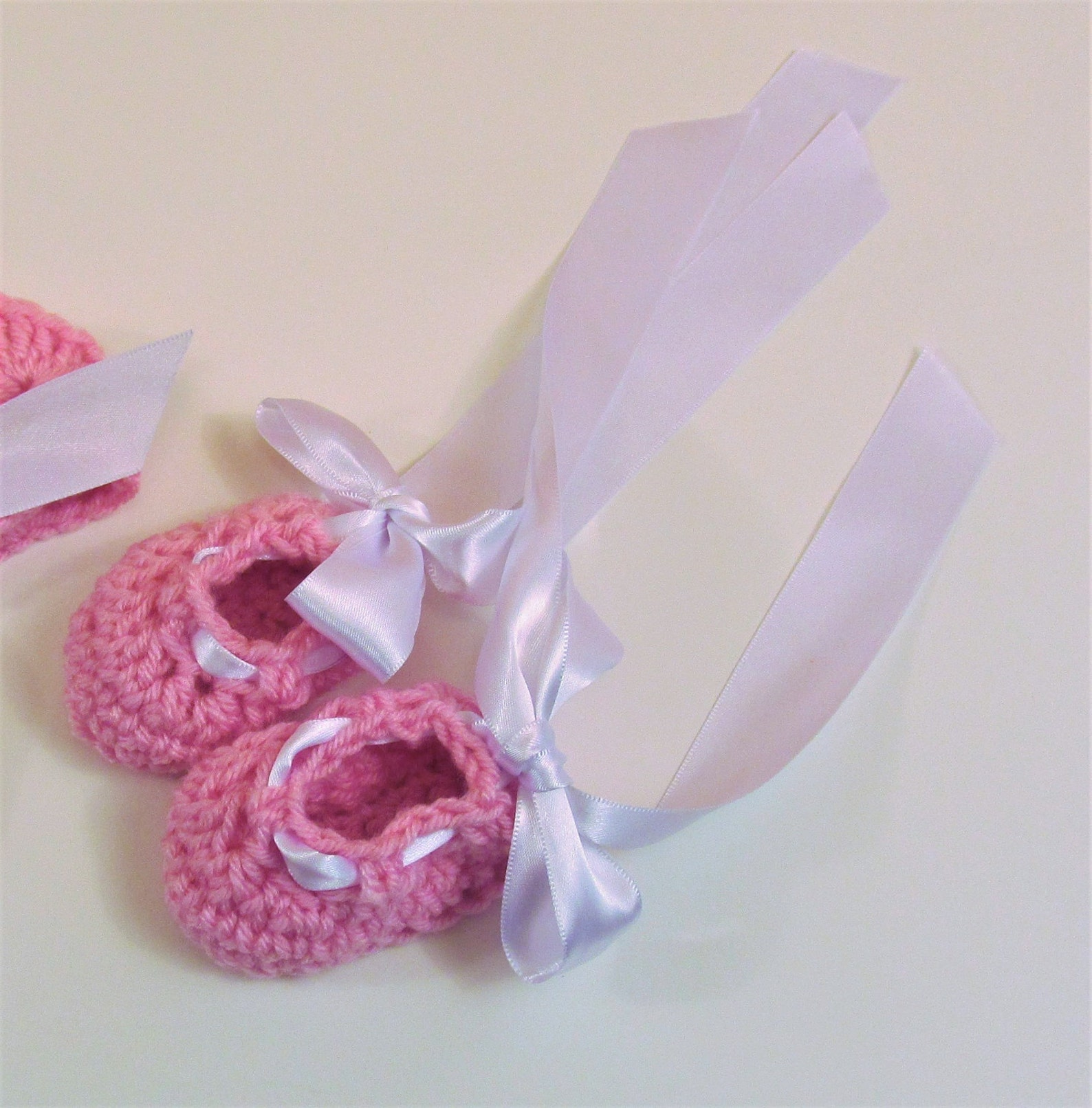 ballet slippers with white ribbon. sizes newborn to 6 months crocheted, photo prop, gender reveal, shower gift or for coming hom