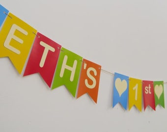 PERSONALISED BIRTHDAY BUNTING.  Happy 1st Birthday bunting.  Festive colours, cream font with hearts