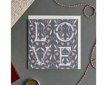 """Wedding & Happy Engagement Card with letters """"LOVE"""" cut out: floral congratulations or anniversary greetings card for husband, wife, fiancee"""