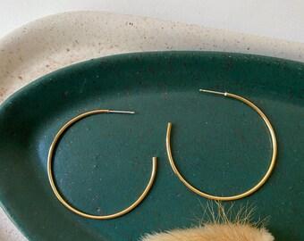 large brass hoop earrings. thin hoop earrings. stud hoop earrings. delicate hoop earrings. minimalist jewelry. gifts for her under 50.