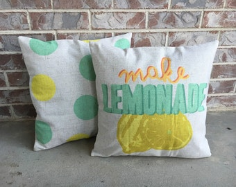 Yellow and green polka dot pillow cover