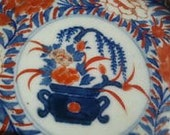 Vintage China or Japanese imari decorative porcelain plate from 1930s. Painted with gold. Well preserved for its age.