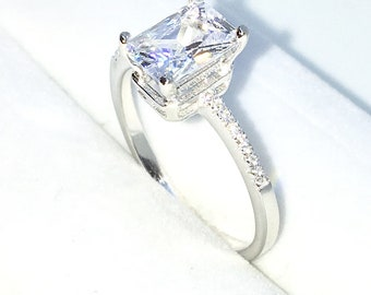 New Handcraft White Gold Plated on Sterling Silver engagement ring band with small white CZ and large 4 prong white emerald CZ