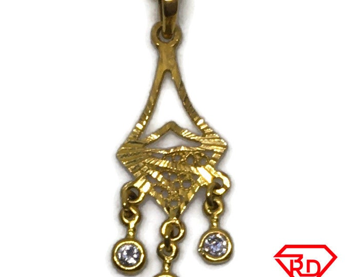 14k Yellow gold Arrow pendant with cubic zirconia