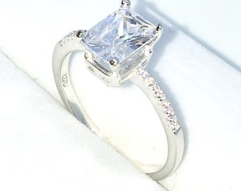New Handcraft White Gold Plated on Sterling Silver engagement ring band with row of small white CZ and large 4 prong white emerald CZ