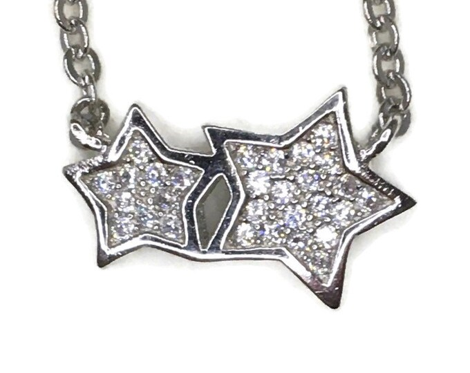 Cubic Zirconia double star pendant with white gold on silver