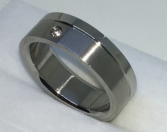 6 . 7mm Size 8 Brand New White Gold Plated with Single Round White Gem and Dented line on Stainless Steel ring band