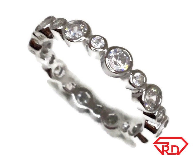 Brand New White Gold on 925 Sterling Silver Eternal Ring Band large and small white round CZ ( size 7 )