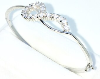 New White Gold Layered on 925 Solid Sterling Silver Oval Bangle Bracelets Curly rows of 4 prong White round CZ and Box clasp