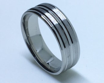 7 . 9 mm Brand New White Gold Plated with bulgy Center line on Stainless Steel ring band