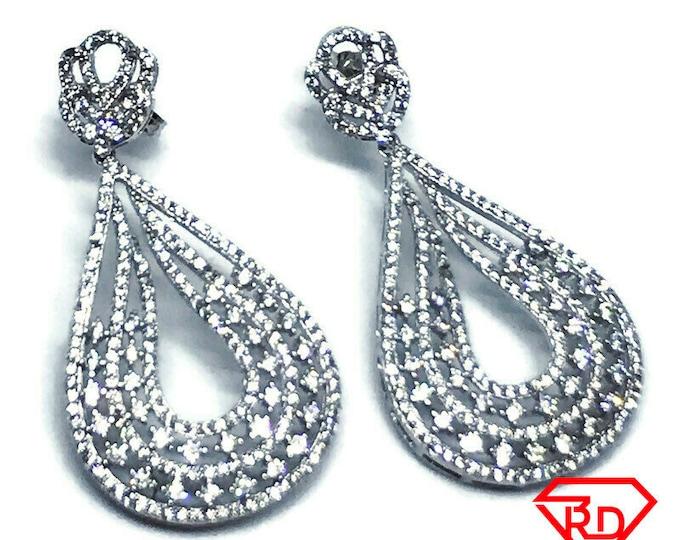 14K white gold on sterling silver lotus on top of teardrop earrings