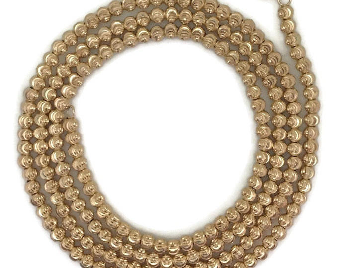 Yellow gold layer on silver necklace Rigid diamond cut beads chain